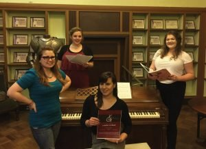 Jessica Stringfield, Amanda Borchers, Victoria Garcia (on bench) and Mary Vosseberg