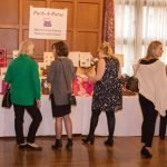 Guests bid on purses in the silent auction.