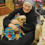 Sister George with the house dog Misty