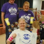 Resident Sue Stewart (seated) with Ruth Schnurr and staff member Tim Weiler