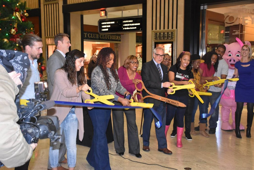 Ribbon cutting for pop shop over the holidays