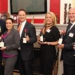 Chairs with wine gifts: Karen Bankston, John Bankston, Lindsay Berding, Jeff Berding, Lauri Prescott and Mike Prescott with Larry Glassmann, Children's Home board chair