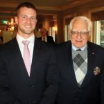 Teacher Zachary Black with Leland Cole, governor of Ohio's Society of Colonial Wars