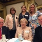 Fident Wealth Partners table: (seated) Bob Reynolds, Elizabeth Reynolds and John Wallace; (standing) Melody Hamilton, Joanne Shreve and Carol Baker