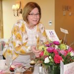 Flower Show board member and Ladies Day committee member Cindy Williams with a donated centerpiece