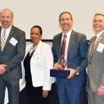 Stephen Smith; Patricia Stewart-Adams, executive director of GRAD Cincinnati; Leigh Fox of Cincinnati Bell; and John Fickle, GRAD Cincinnati president