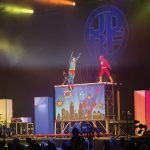 Aerialists and trampoline artists dressed as superheroes performed