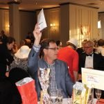 Hal Theobold bids in the live auction.