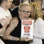 """Joules Evans with her signed copy of """"Secrets of the Art World"""""""