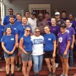 GE volunteers and Habitat's AmeriCorps members with homeowners and an Army veteran