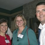 Executive director Christie Brown and board member Vicki Gardner with Justin Flamm of honoree Taft Law