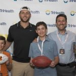 Host Bengals player Tyler Eifert with guests