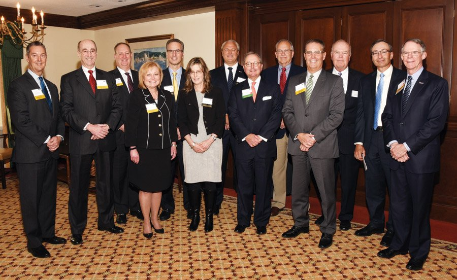 "(Back) Richard Bodner, Ohio National Financial Services; Art Roberts, ONFS; Chris Carlson, ONFS; Chris Calabro; Mike Prescott, president, Cincinnati Market, U.S. Bank; Hal Klink, ONFS; Howard Becker, ONFS; Paul Gerard, ONFS; Richard Davis, chair of U.S. Bancorp; (front) Kristal Hambrick, ONFS; Angie Meehan, ONFS; Gary T. ""Doc"" Huffman, ONFS chairman, president and CEO; and Tony Esposito, ONFS"