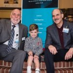 Shriners board chair David Aaronson, young patient Dylan and Shriners chief administrator Mark Shugarman