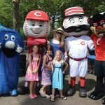 Xavier Blue Blob, Mr. Red, Mr. Redlegs, and UC Bearcat with fans