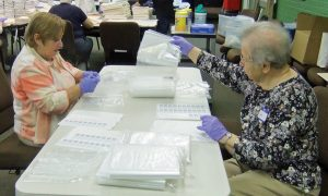Janet Bender and Joan Mettey labeling bags