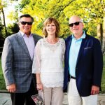 Board president John Mongelluzzo, board member Kelly Hitter and Chris Adams, Stepping Stones executive director