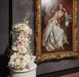 """Longtime volunteer artist Pinky Laffoon created a luscious pale rose-filled piece for the museum's beloved """"Ann Ford,"""" by Thomas Gainsborough. Her floral creation was voted the favorite at the 2015 Art in Bloom."""