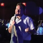 Emcee Bob Herzog of Local 12 auctions his favorite retro blue denim jacket.