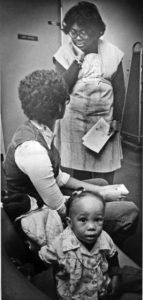Dolores Lindsay, with a patient and child, circa 1970