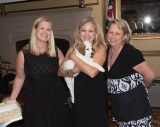 Melanoma Know More executive director Leanne Blair; Debbie Williams, winner of a puppy named Tweed; and board member Tami Burgoyne