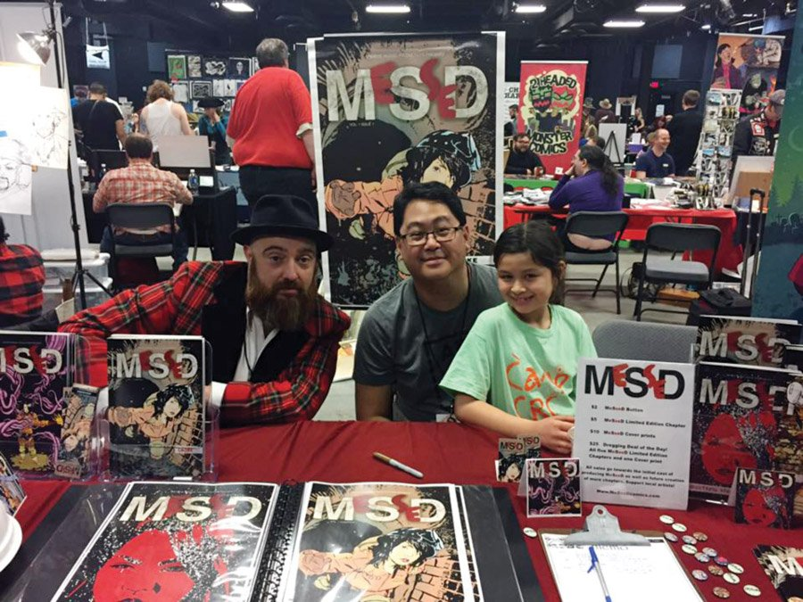Illustrator Dylan Speeg, writer Jay Kalagayan and his daughter Meggie, at SPACE 2017 Columbus, a Small Press and Comics Expo