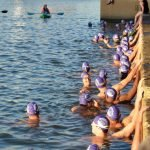 Purple caps signify swimmers who are racing.