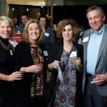 Committee member Julie Ross; Alison Waring, who donated a necklace for the raffle; Sue Schlueter; and Mark Schlueter