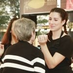 Aveda student doing makeup for a guest