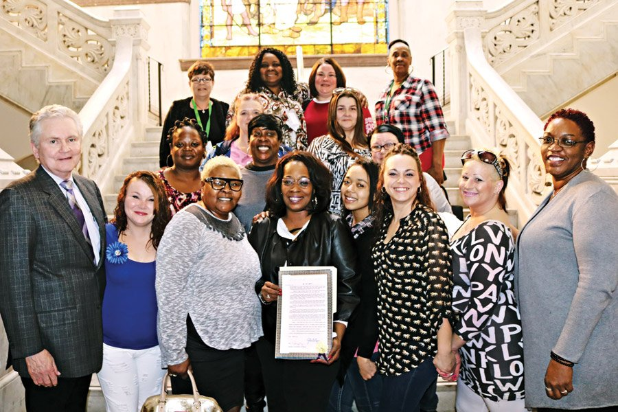 Viann Barnett, with clients and CUB president/CEO Stephen T. MacConnell, as she is honored by City Council as Woman of the Month