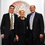Kay Geiger with Nehemiah Manufacturing president Richard Palmer (left) and CEO Dan Meyer