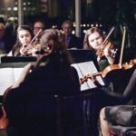 Starry Soiree guests enjoying an SCPA string quartet performance