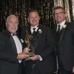 Honoree Tim Beischel, board president John Strawser and keynote speaker Scott Sloan