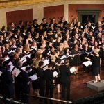 Young Professionals Choral Collective onstage at Memorial Hall