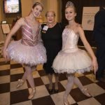 Kathy Wilkinson, general chair of A Melody of Light, with dancers from the Cincinnati Ballet Academy.