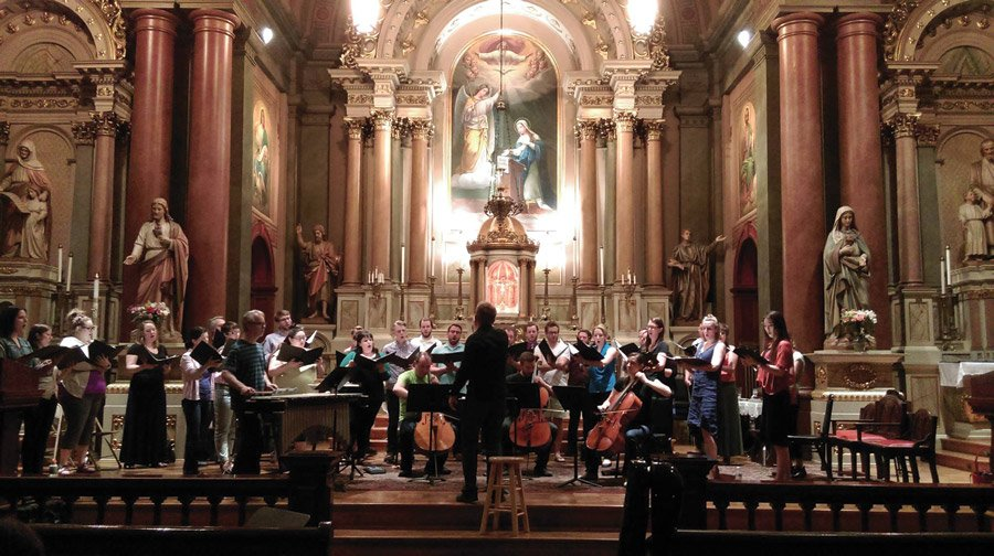 "Conductor Craig Hella Johnson leads VAE in a rehearsal of ""Canticle"" in 2016."