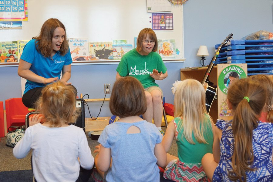 Elaine Ramage, a board-certified music therapist, and Kara, who was part of a teaching pair leading music and literary sessions
