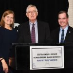 Board chair Mary Rust, honoree Bob Watkins and CEO John H. Mitchell