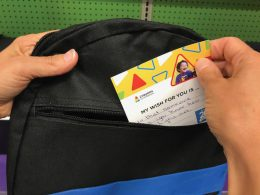 A card going into backpack