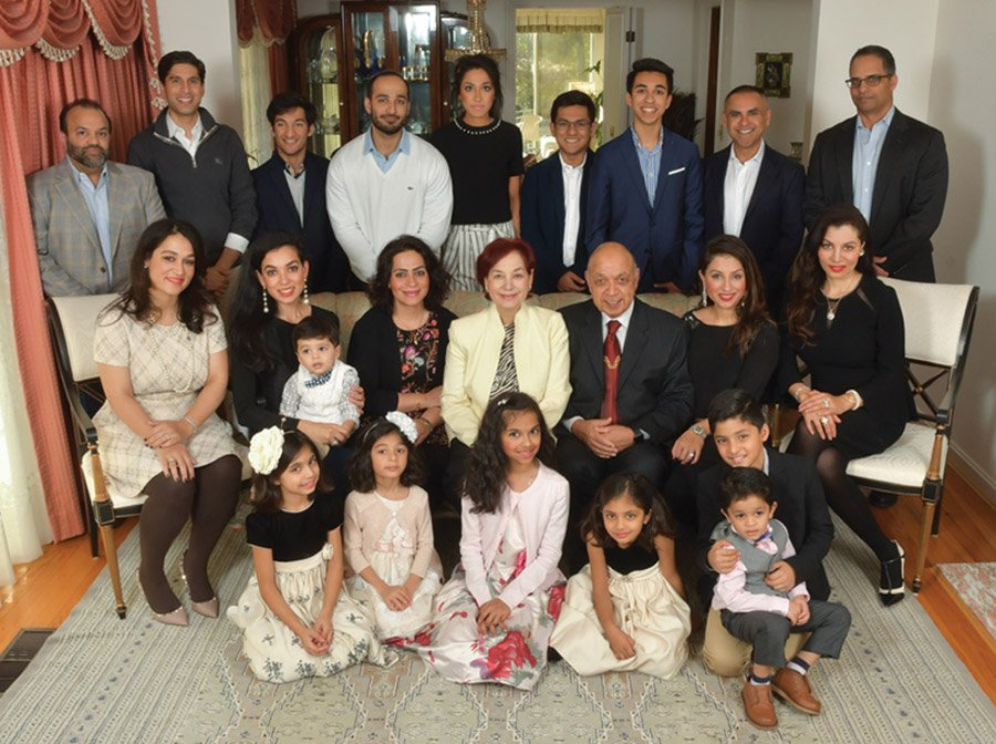The Maliks (center) with their daughters and families