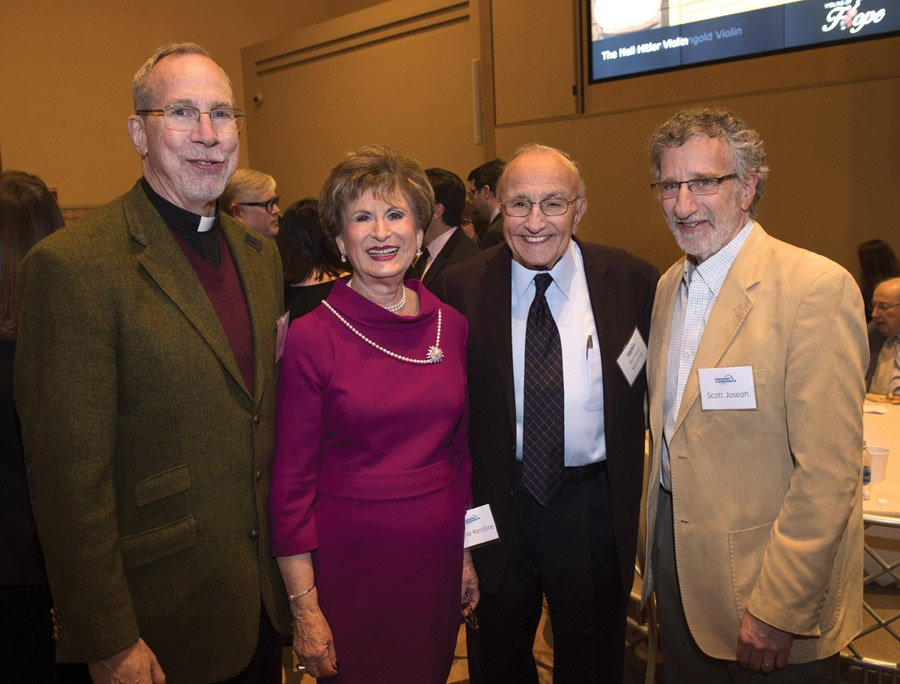 Father Michael Graham, president of Xavier University and an HHC board member; Mona Kerstine, committee member; and Richard Kerstine and Scott Joseph, event sponsors