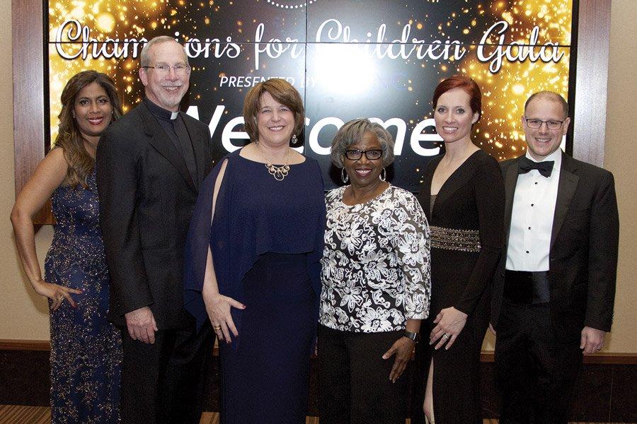 Co-chair Zamaris Geleszinski, honoree Rev. Michael Graham, 4C president/CEO Vanessa Freytag, honoree Diane Jordan-Grizzard, co-chair Christy Stockton and 4C board chair Emerson Moser