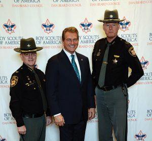 Chief Deputy Mark Schoonover, Joe Theismann, and Sheriff Jim Neil