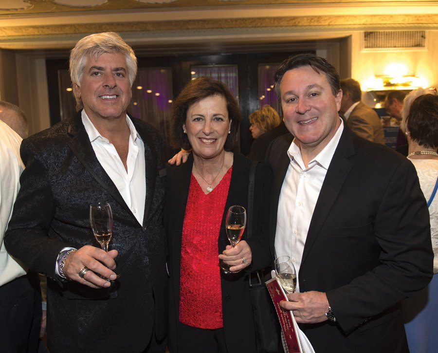 Board member John Mocker, 2017 honorary chair Genevieve Janssens and Tim Beattie of Constellation