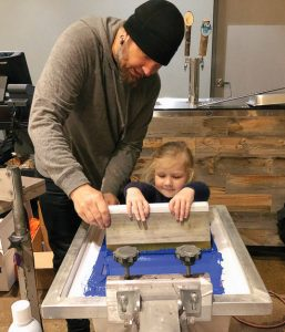 Aaron Kent of DIY Printing and child