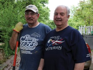 A Hixon volunteer and veteran with client Roger Willis, also a veteran, at an earlier event