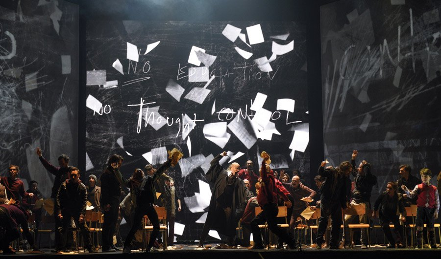 A tyrannical teacher (Dominic Lorange) punishes his riotous students in Cincinnati Opera's production of Another Brick in the Wall. Photo by Yves Renaud/Opéra de Montréal.