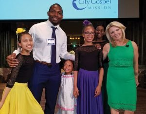 Vincent Rey of the Cincinnati Bengals and Sheree Paolello of WLWT with City Gospel Mission's Princesses Ballet dancers