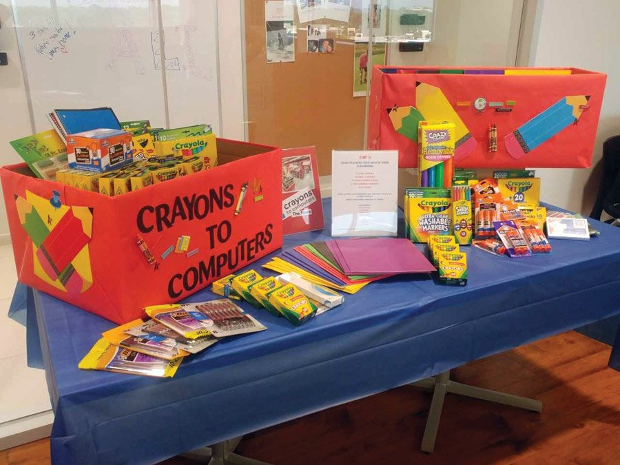 Crayons to Computers Push Pencils The school supply collection table at Assured Partners, one of the many participating companies last year
