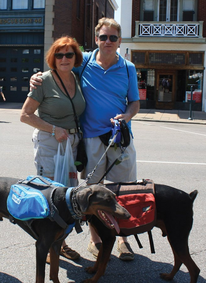 Hyde Park Farmers' Market Peg Moertl and Steve Saunders shopping with their pack dogs.